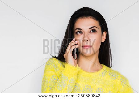 Close Up Portrait Of Serious Young Beautiful Woman Using Smart Phone Over Light Grey Background. Pre