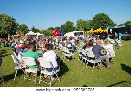 TENTERDEN, ENGLAND - MAY 20, 2018: People enjoy the annual Food and Drink Festival at Tenterden in Kent. The event was first held in 2017.