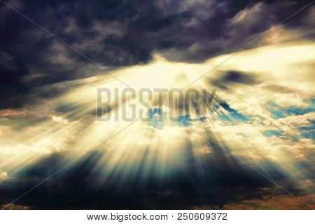 Dramatic Sky Cloudscape After Thunderstorm With Sunshine Nimbus. Rays Of Sunlight Coming Through Clo