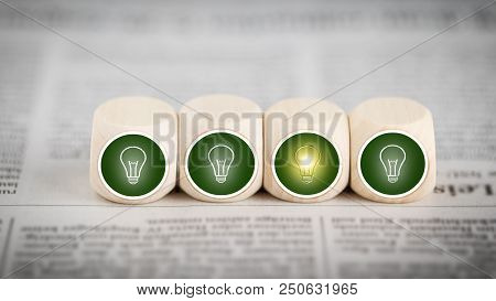 Idea - Lightbulb Icons On Cubes On A Newspaper