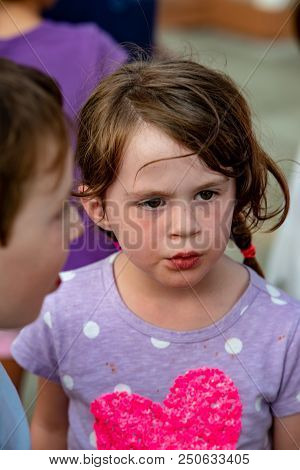 View Of Happy Young Girl Having Fun On Boardwalk Amusement Ride