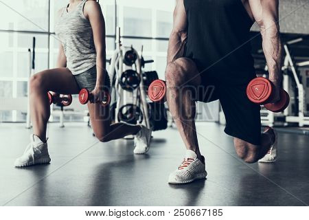 Close Up. Man And Woman Training In Fitness Club. Man With Athletic Body. Healthy Lifestyle And Spor