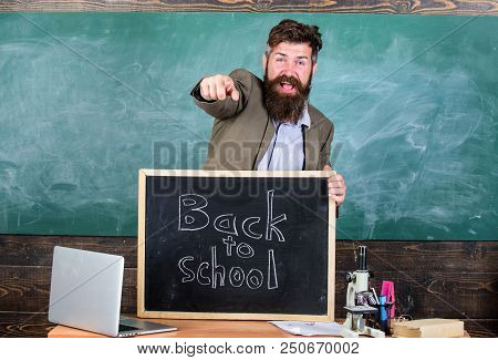 Full Of Energy After Summer School Holidays. Teacher Or Educator Welcomes Inscription Back To School