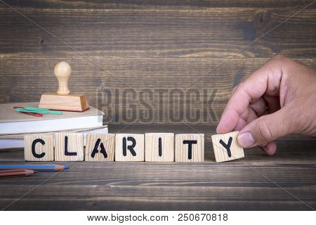 Clarity. Wooden Letters On The Office Desk, Informative And Communication Background