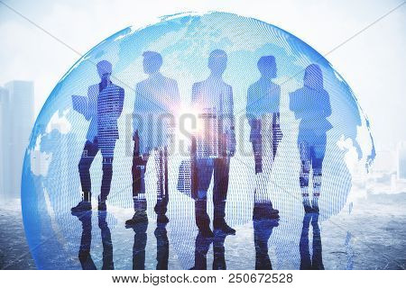 Businesspeople On Abstract City Background With Globe And Daylight. Global Business And Globalizatio