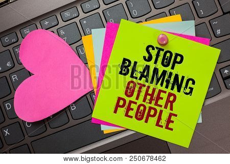 Text sign showing Stop Blaming Other People. Conceptual photo Do not make excuses assume your faults guilt Bright colorful written papers pinch by pin pink heart on computer keyboard poster