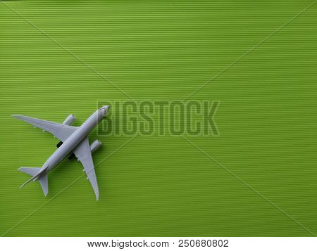 Toy airplane on green background