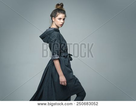 Woman. Stylish Woman In Autumn Coat. Woman On Grey Studio Background, Copy Space. Pretty Woman With