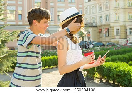 Couple Of Teens Are Having Fun In The City, Summer Holidays, Education, Teenage Concept