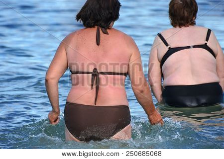 Overweight Woman In Swimsuit Near The Sea. Size Plus Or King Size Woman