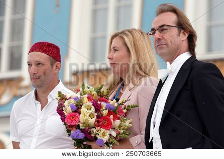 ST. PETERSBURG, RUSSIA - JULY 22, 2018: Conductor Fabio Mastrangelo (right), PR director Ekaterina Kashina (center), and art-director Victor Vysotsky on the closing of the festival All Together Opera