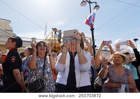 ST. PETERSBURG, RUSSIA - MAY 27, 2018: People make photo of Drummers parade on Nevsky avenue. The parade is a part of City Day celebrations which is timed to the day of foundation of Saint Petersburg