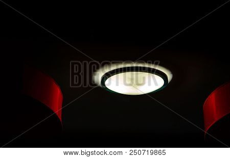 Interior Ceiling Lights On Dark Background At Night. Interior Lighting Concept. Round Glass With Bla