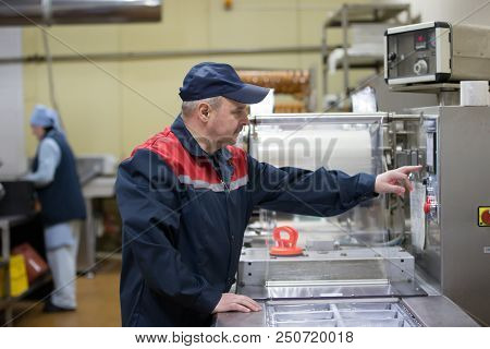 Belarus, The City Of Gomel, On April 26, 2018. Meat Plant. Working Packer For Packing Machine