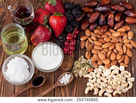 Berries, Nuts, Coconut Milk And Butter, Maple Sirup. Ingredients For Raw Vegan Cheesecake With Caram