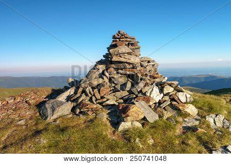 Stack Of Rocks Marking A Mountain Peak