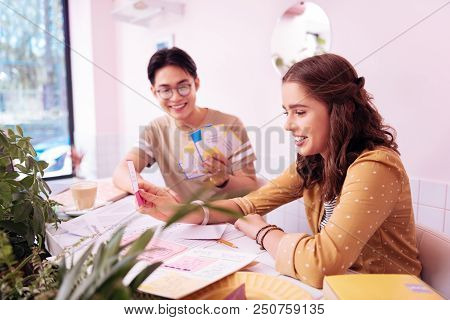 Studying Language. Blonde-haired Young Student Studying Foreign Language With Boyfriend Sitting In C
