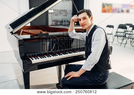 Professional pianist at the black grand piano