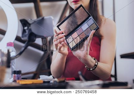 Eye Shades Palette. Beautiful Charming Woman With Beige Nail Art Holding Eye Shades Palette