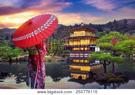 Asian Woman Wearing Japanese Traditional Kimono At Golden Pavilion. Kinkakuji Temple In Kyoto, Japan