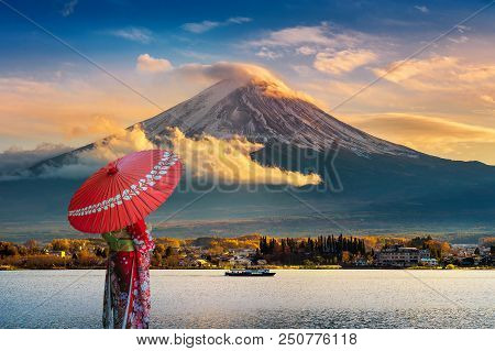 Asian Woman Wearing Japanese Traditional Kimono At Fuji Mountain. Sunset At Kawaguchiko Lake In Japa