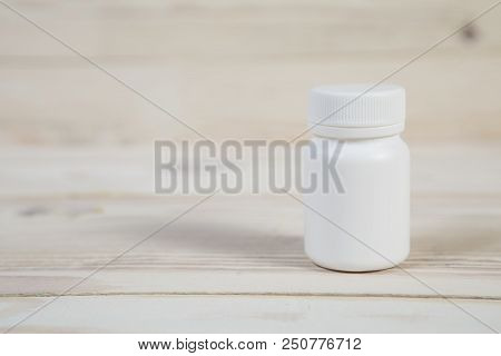 Medicine Bottle. Blank Medicine Bottle Isolated On Wooden Background