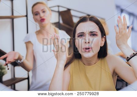 Confused Result. Dark-eyed Stylish Woman Feeling Really Confused Seeing Result Of Makeup In Beauty S