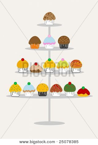 A selection of delicious cupcakes and muffins presented on multi-tiered display stand.