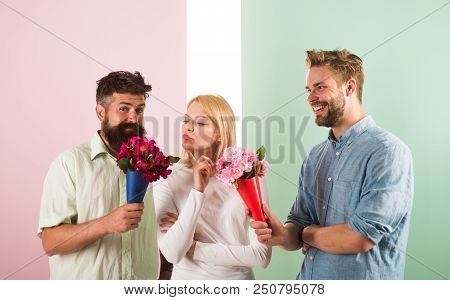 Men Competitors With Bouquets Flowers Try Conquer Girl. Girl Likes To Be In Middle Attention. Girl P