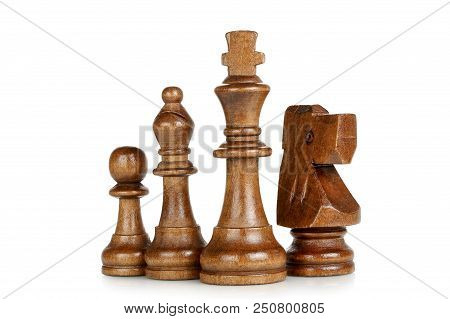 Wooden King, Knight, Bishop And Pawn Isolated On White