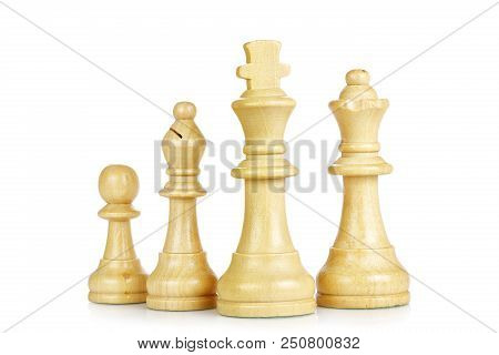 Wooden King, Queen, Bishop And Pawn Isolated On White
