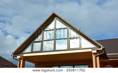 Building House Attic Conservatory Terrace On The Home Roof With Panoramic View. Conservatory Or Gree