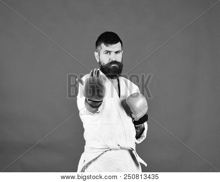 Combat Master Asks To Approach Provoking Fight. Man With Beard In White Kimono On Green Background.