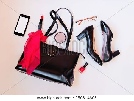 Top View Of Black Leather Bag, Black Shoes, Smartphone, Glasses And Cosmetic