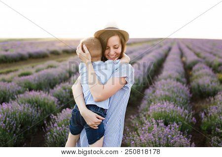 Young Woman In Blue Dress Hat Walk On Purple Lavender Flower Meadow Field Background, Rest, Have Fun