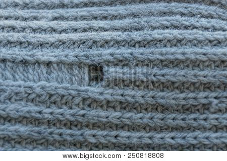 Gray Texture Of Woolen Fabric With A Hole