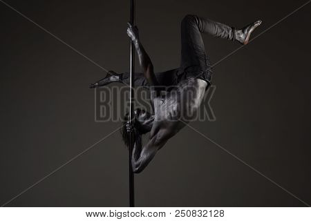 Strong Dancer On Pole. Freedom. Sexy Macho With Metal Skin. He Got The Moves. Muscular Man With Silv