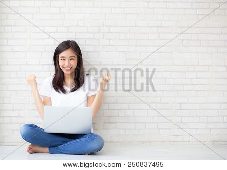 Beautiful Of Portrait Asian Young Woman Excited And Glad Of Success With Laptop Computer, Girl Sitti