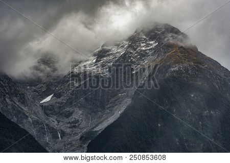 Mountain, Misty, Cloudy, Sunlight, Snow, Water Cascades. Misty Clouds Float Above Snowy Mountain Top