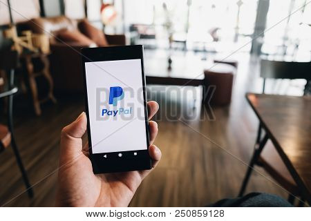 Chiangmai, Thailand - July 07, 2018: Hand Holding Sony Mobile Phone On Paypal Logo Screen. Paypal Is
