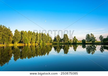 A Small Lake On A Quiet Summer Evening.