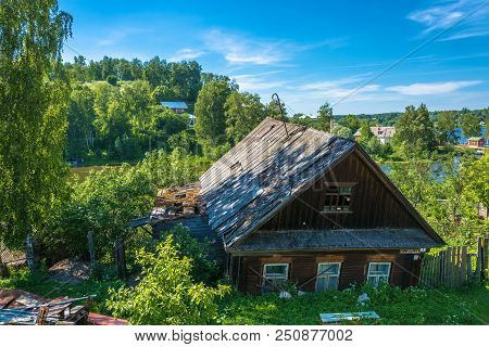 An Old Wooden House, Gone Through The Window To The Ground, Russia.