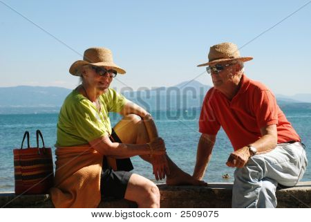Romantic Elderly Couple Enjoying Retirement By The Lakeside