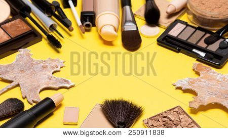 Autumn Makeup. Make-up Products With Maple Leaves Made Of Bark On Yellow Background, Copy Space In T