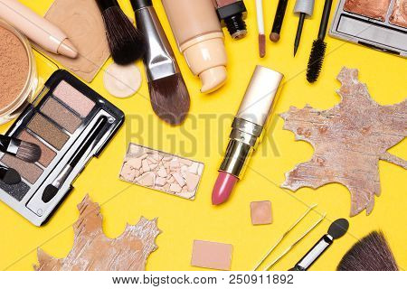 Autumn Make Up Flat Lay. Beauty Products For Natural Makeup With Maple Leaves Made Of Bark On Yellow