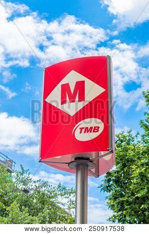Barcelona, Spain - June 7, 2018: Barcelona Tmb Metro Station Sign. Metro Sign Of Transports Metropol