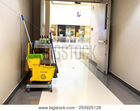 Cleaning Tools Cart Wait For Maid Or Cleaner In The Department Store. Bucket And Set Of Cleaning Equ