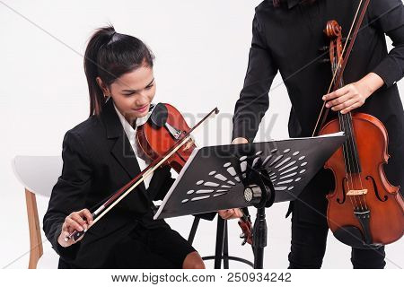 The Beauty Lady In Black Uniform Is Studying Violin By The Violin Teacher,at Studio Music Room,violi