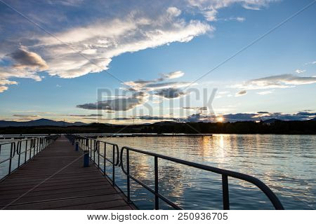 Breathtaking view. Sunrise sunset gazing from wooden pier over sea, copy space, wallpaper.