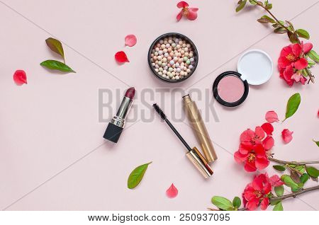 Various cosmetic products for make-up with red flowers on a pink background with copy space. Makeup Accessories Top view Flat Lay. Powder Rouge Eyeshadow Pomade Brushes Mascara poster